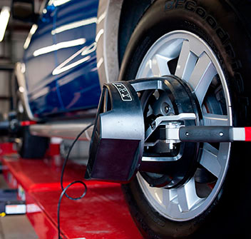 Working on 4-wheel alignment services
